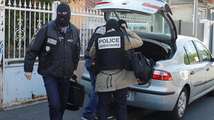 French police leave the house of the gunman killed in a shootout with police on the Champs Elysees Avenue, in the Paris suburb of Chelles, France, April 21, 2017.