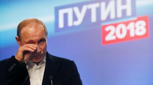 Владимир Путин в своем штабе в Москве, 18 марта 2018 г.