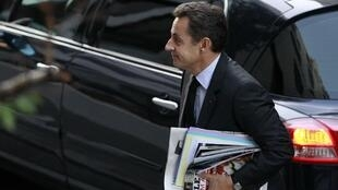 President Nicolas Sarkozy arrives for a morning visit at the maternity clinic