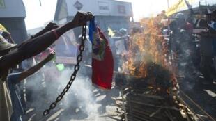 L'opposition haïtienne a une nouvelle fois manifesté samedi 13 décembre pour réclamer le départ du gouvernement et du président Martelly.