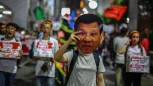 Lors d'une manifestaiton à Manille le 10 décembre 2019, pour marquer la journée internationale des droits de l'homme.