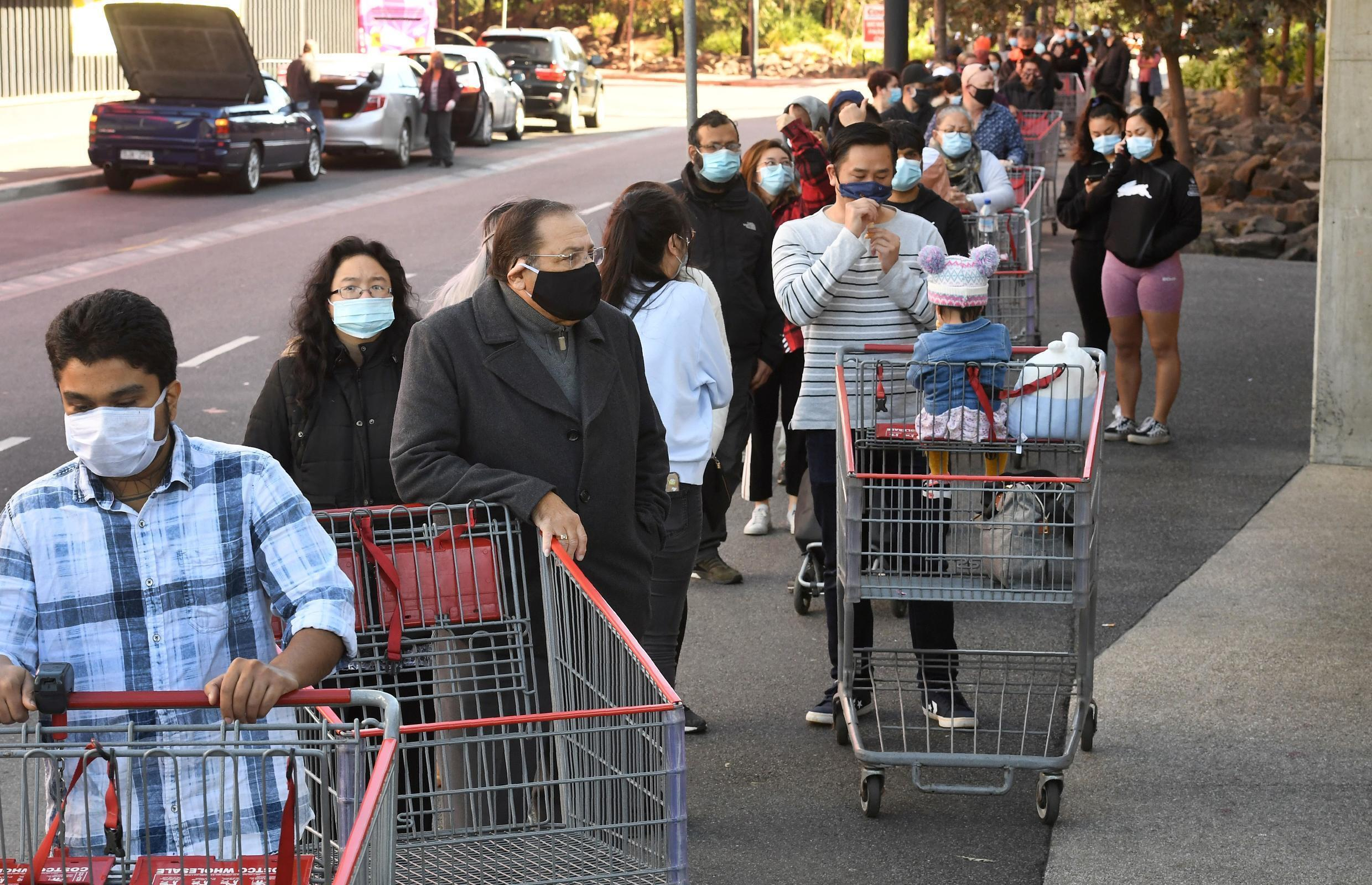 Residents of Melbourne city, Australia, queue up to buy groceries ahead stage 4 of a new lockdown against Covid-19, announced on 2 August 2020.