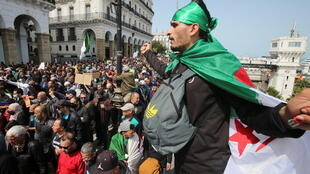 2021-04-09T150447Z_567164917_RC2FSM9HXQR4_RTRMADP_3_ALGERIA-PROTESTS