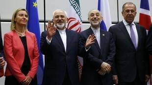 The EU's Federica Mogherini (L), Iran's Mohammad Javad Zarif, Russia's Sergei Lavrov (R) in Vienna after the deal was signed