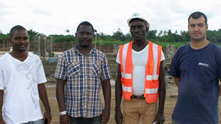 Staff at the construction site for International Medical Corps' Port Loko Ebola treatment centre, 8 November