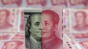 美元與人民幣百元面值鈔票圖像