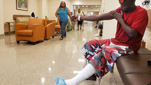 A survivor from Abaco island receives treatment at Princess Margaret hospital, Nassau,  6 September.