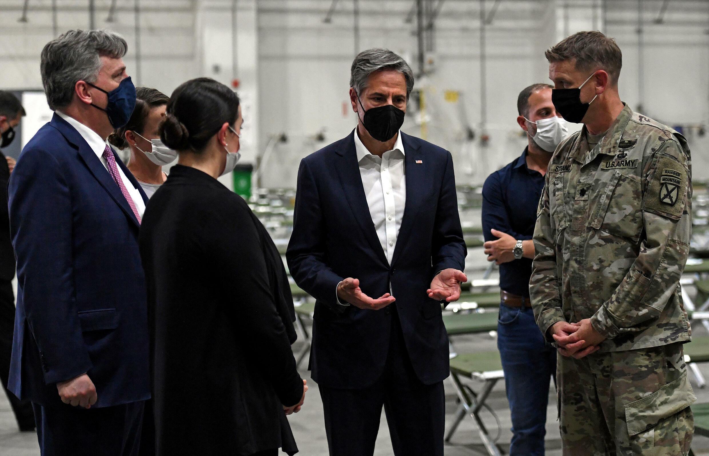 US Secretary of State Antony Blinken (C) tours a processing centre for Afghan refugees at Al-Udeid airbase outside Doha on September 7, 2021