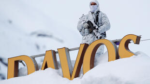 Marksman with Swiss police keeps a watchful eye from top of Davos Congress Hotel.
