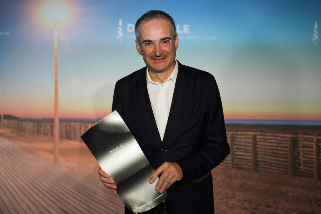 French director Olivier Assayas holding his Deauville Festival Award for his film 'Wasp Network', 14 September 2019