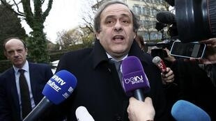 Uefa president Michel Platini speaks to media as he arrives with his counsel Thomas Clay (L) for a hearing at the Court of Arbitration for Sport (CAS) in Lausanne, Switzerland December 8, 2015.