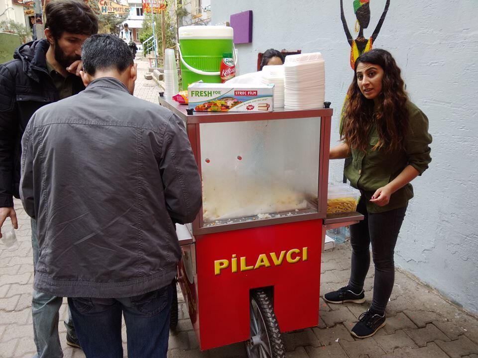 Mehtap Yörük serves a customer at her stall in Diyarbakir.