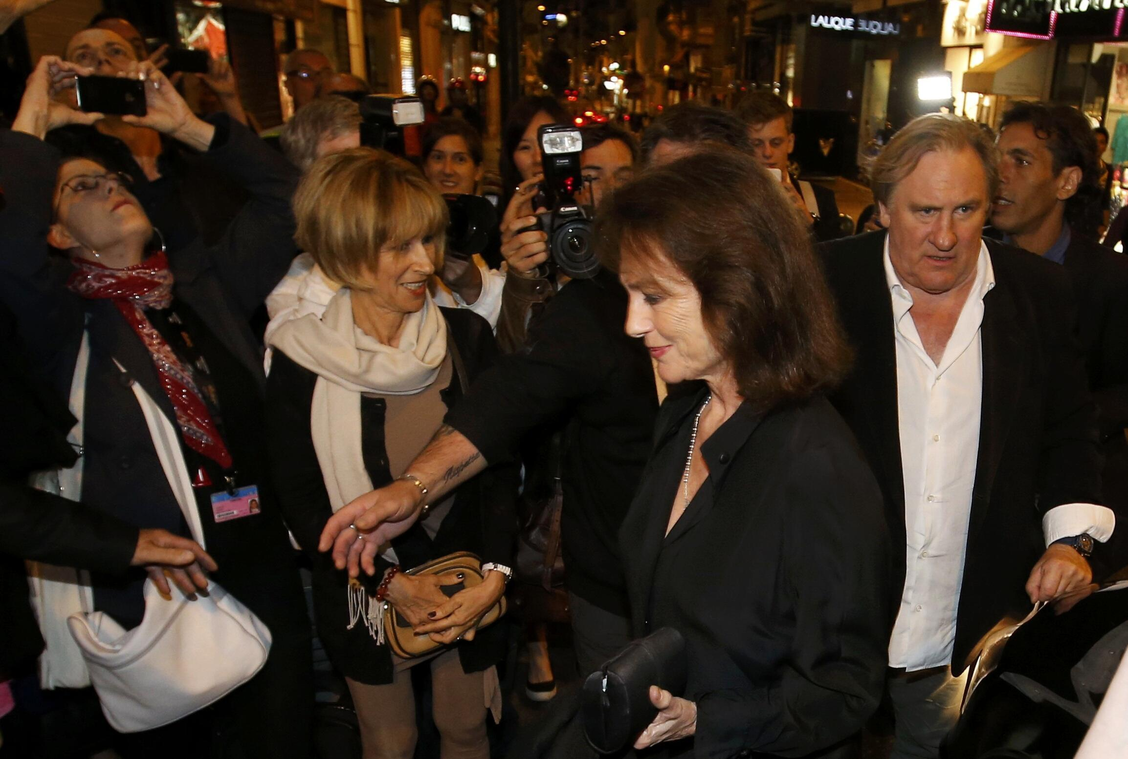 """Gerard Depardieu and Jacqueline Bisset arrive for the screening of the film """"Welcome to New York"""",  Cannes  17 May 2014."""