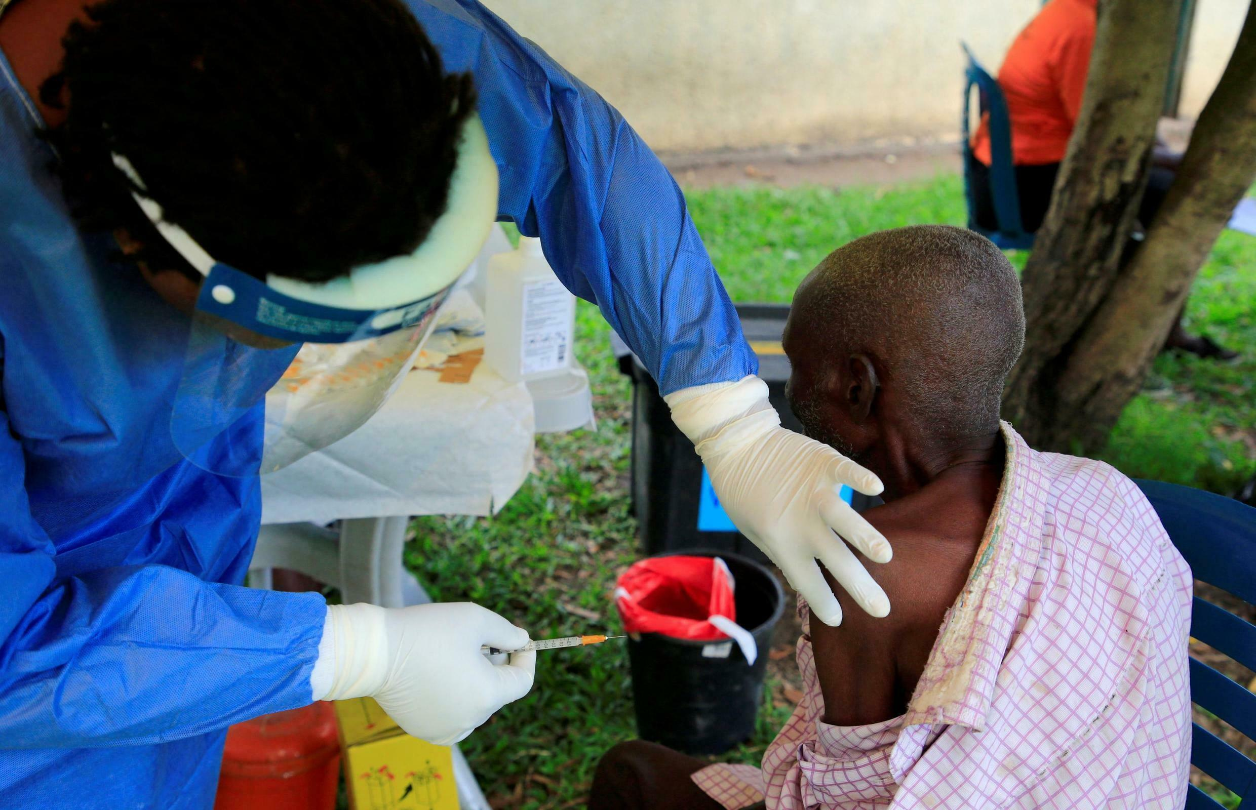 A Ugandan health worker administers ebola vaccine to a man in Kirembo village, near the border with the Democratic Republic of Congo in Kasese district, Uganda June 16, 2019.
