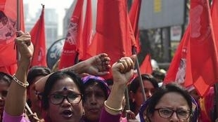 Bangladeshi women march in the street as they take part in a rally to mark International Women's Day in Dhaka, 8 March 2019.