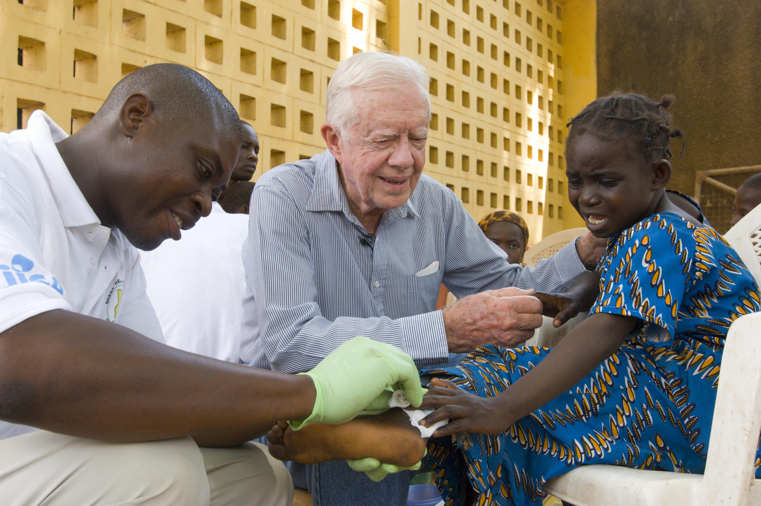 Former US President Jimmy Carter tries to comfort 6-year-old Ruhama Issah at Savelugu (Ghana) Hospital.