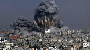 Clouds of heavy smoke billow into the air following an Israeli military strike in Gaza City on July 29, 2014