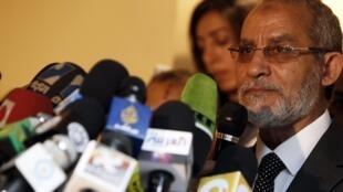 Mohammed Badie, leader of Egypt's Muslim Brotherhood, talks to journalists outside Cairo on 30 November, 2010.