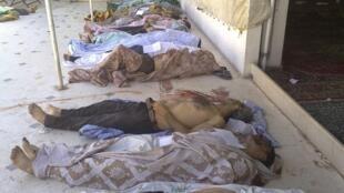 Des corps de victimes d'exactions de l'armée syrienne à Daraya, le 26 août 2012.