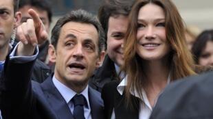 El presidente Nicolas Sarkozy con la primera dama Carla Bruni Sarkozy.