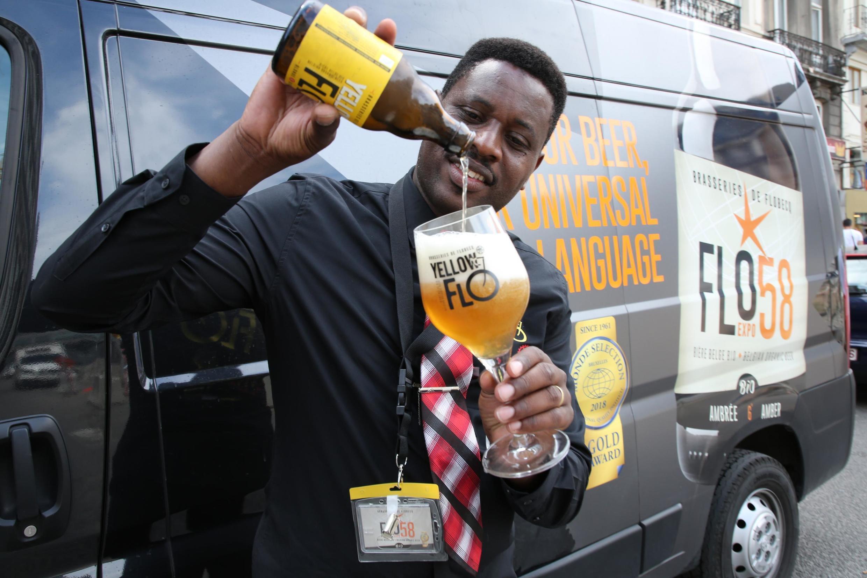John Christian Kavakure pours his beer brand Yellow Flo into a custom made glass.