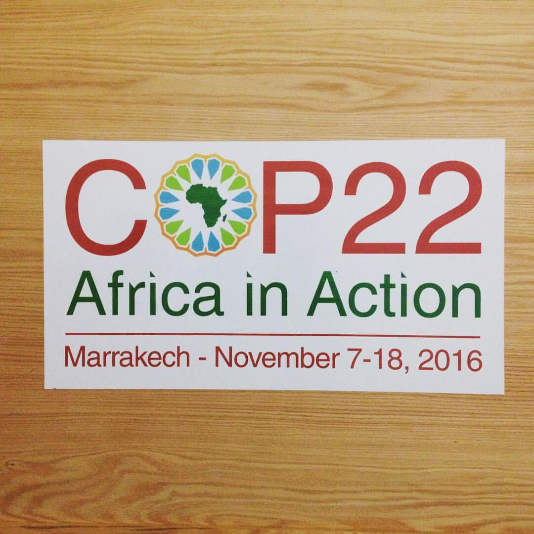 """A poster reading """"COP22 Africa in Action"""" hangs in the Africa pavillon in the COP village at Marrakesh"""
