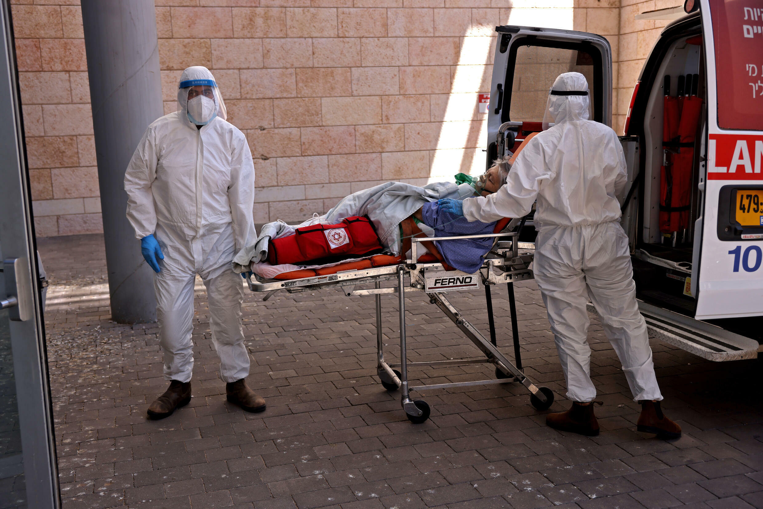 Growing numbers of Israeli hospitals have reached full capacity following a surge in Covid infections, forcing medics to transfer this patient to Jerusalem's Hadassah Ein Kerem Hospital earlier this week