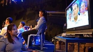 It's Not a Dream producer Prak Sokhayouk watches a screen during a recording of the Cambodian reality show that reunites families torn apart by the Khmer Rouge
