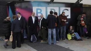 People queue outside BBC Television Centre to watch a show in London