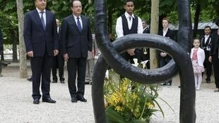 François Hollande and Speaker of the French Senate Jean-Pierre Bel attend a ceremony at the Luxembourg Gardens in Paris to mark the abolition of slavery.