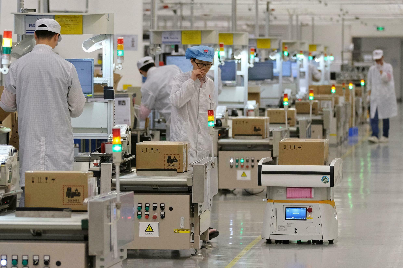 Chaîne de production de téléphones portables située dans l'usine de Huawei à Dongguan, en Chine.