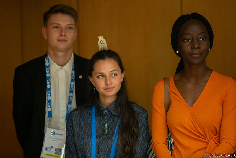 Young leaders, including Victoria Ibiwoye (R) gather at Paris' Unesco headquarters to exchange with heads of state on global cooperation and how to boost youth engagement in decision-making, 12 November 2019
