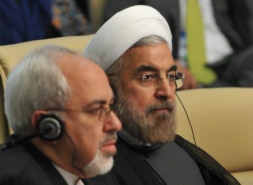 Iranian President Hassan Rohani (R)