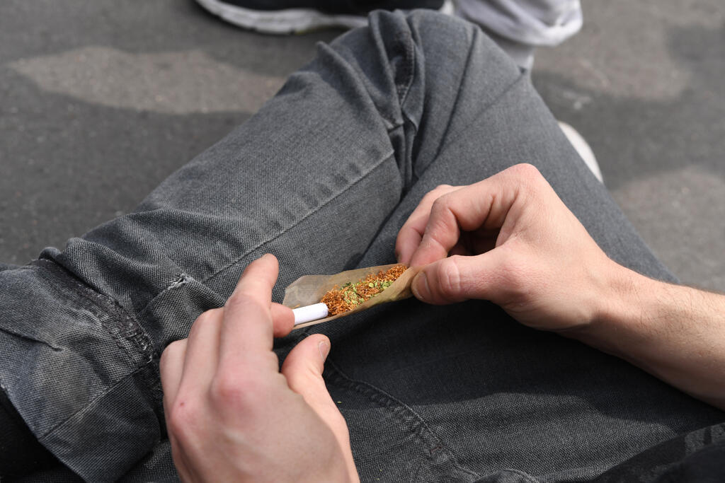 Someone rolls a joint in Paris last year, during the 16th annual Marché Mondiale du Cannabis to call for the legalisation of cannabis.