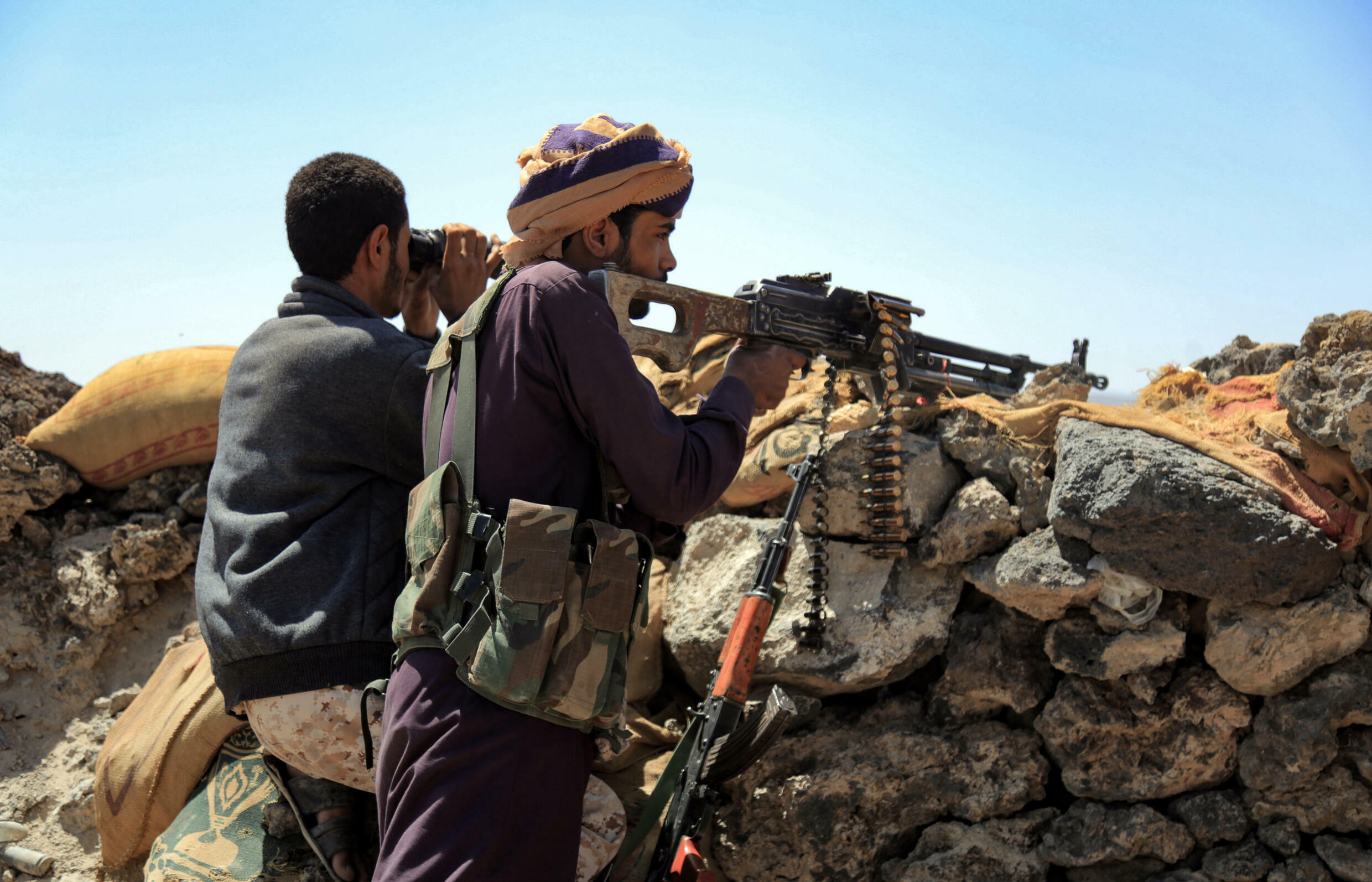 Fighters loyal to Yemen's Saudi-backed government man a position near the front line facing Iran-backed Huthi rebels in the country's northeastern province of Marib, on October 17, 2021