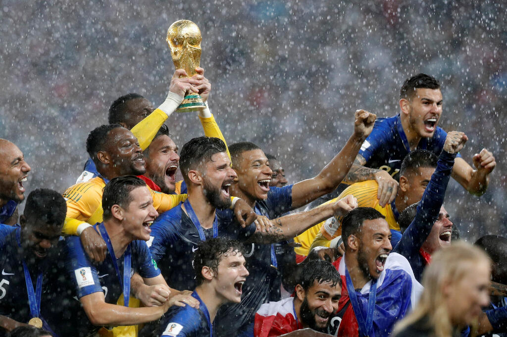 The French football team raise the World Cup after beating Croatia, 4-2 at the Luzhniki stadium in Moscow, 15 July, 2018.