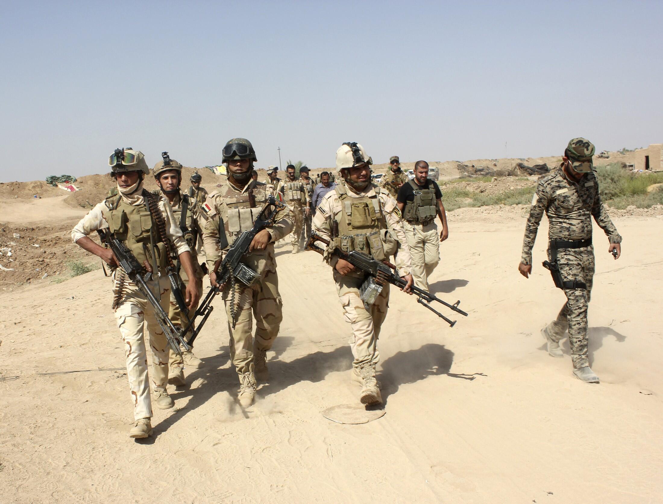 Quân đội Irak và dân quân si-ai nỗ lực chiếm lại thành phố Amerli trong tay tổ chức EI.