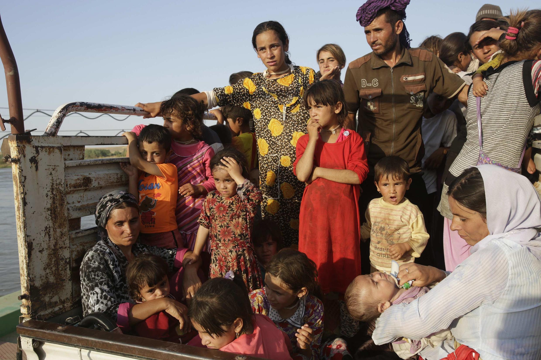 Езиды в провинции Дохук в Ираке, на границе с Сирией. 14 августа 2014 год