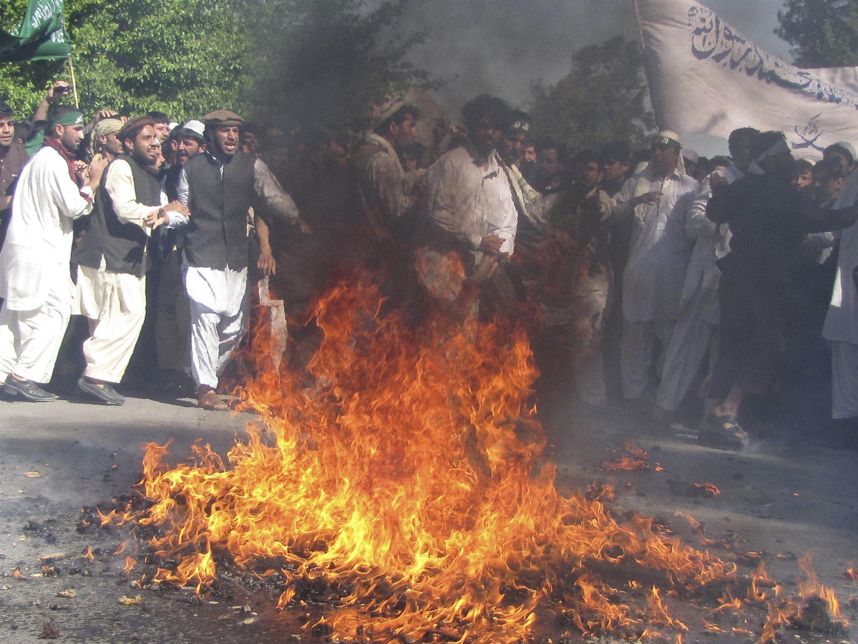Protestors burn US flag during demonsrations
