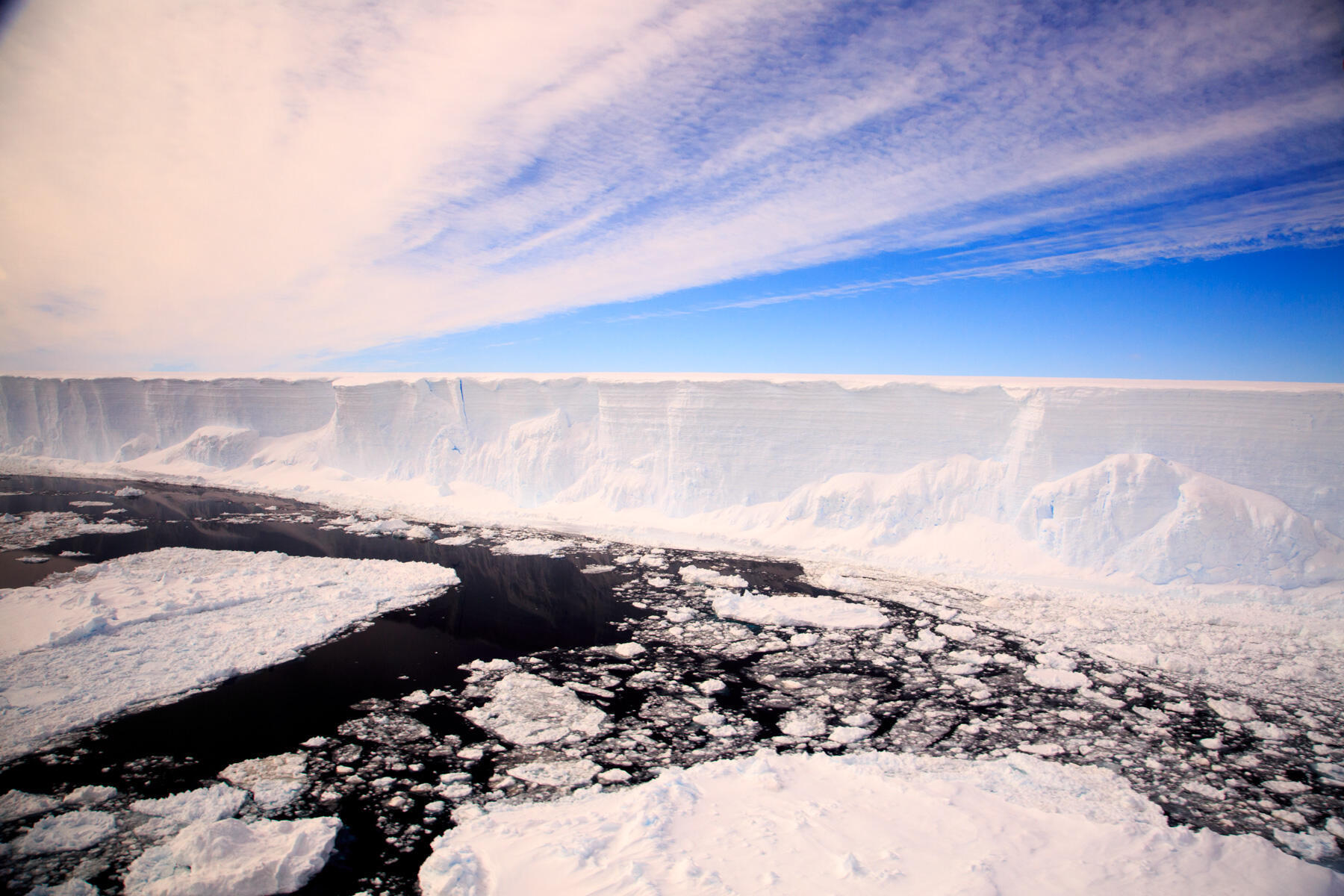 Melt water running into deep fissures caused by warming air is undermining the structural integrity of Antarctica's ice shelves