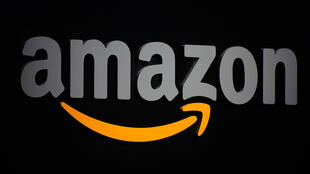 The logo of American online retailer Amazon, which employs nearly 10,000 people in France