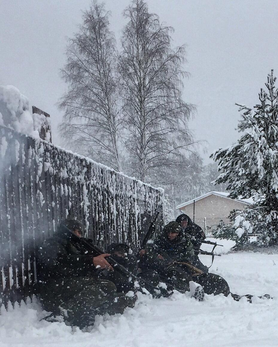 Lithuanian military reservists storm a building as part of joint exercises with the Lithuanian Riflemen's Union.