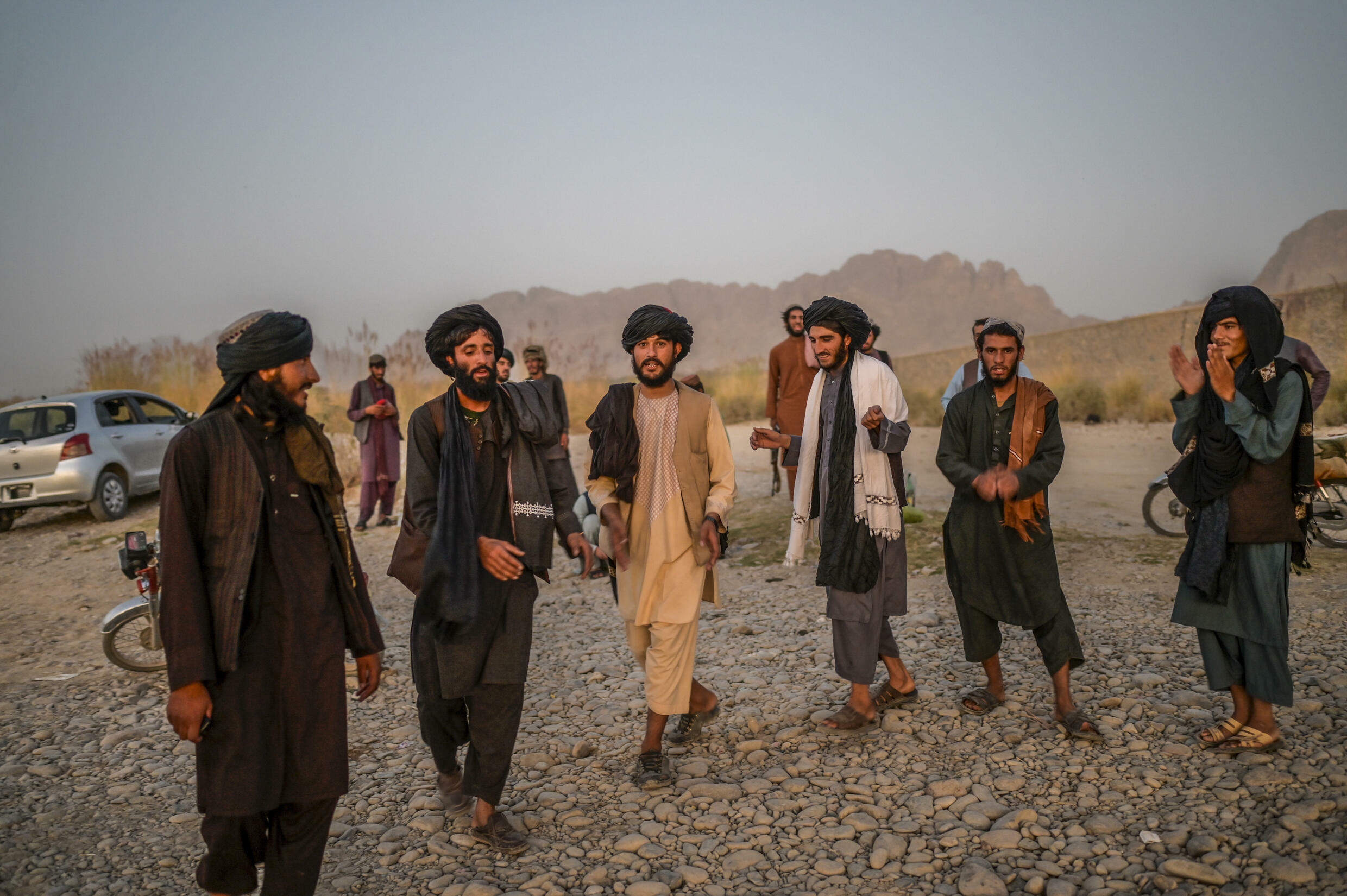 Young members of the Taliban dance and sing next to a river near Kandahar