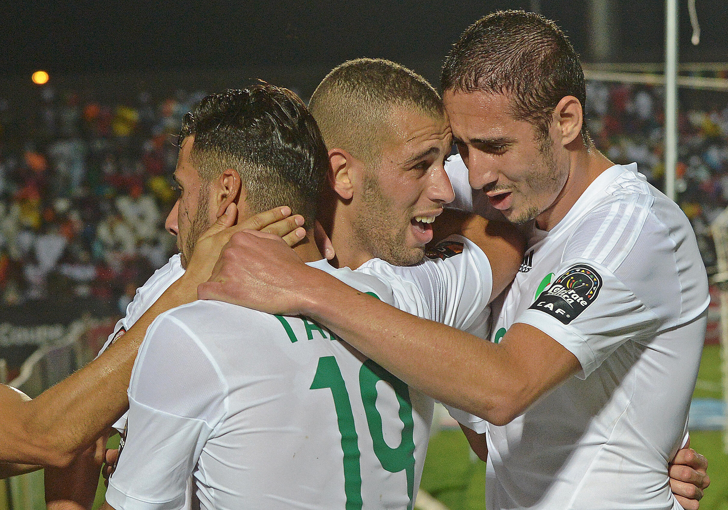 Algeria's Islam Slimani (c) congratulates his teammates after a goal against South Africa