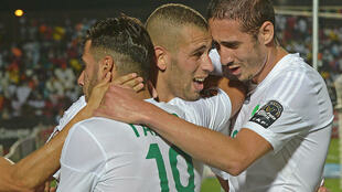 Algeria's Islam Slimani (c) congratulates his teammates after a goal against South Africa