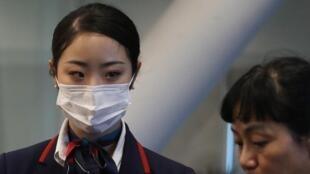 武汉肺炎疫情中的中国乘务人员资料图片