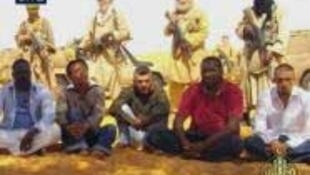 Qatari Al-Jazeera channel showed pictures of French hostages in Niger on 30 September.