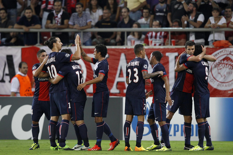 Jogadores do PSG comemoram a vitória por 4 a 1 contra o Olympiacos, na terça-feira 17 de setembro de 2013