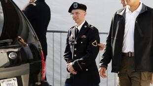 Army Private First Class Bradley Manning (C) is escorted as he leaves the courthouse in Fort Meade, Maryland, 6 June 2012