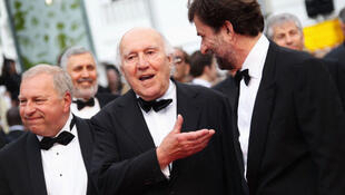 Michel Piccoli (centre) with Italian film director Nanni at the screening of Habemus Papam at the 64th Cannes film festival, 13 May 2011.